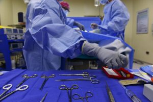 Surgeon implanting artificial hip