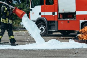 Firefighter using AFFF foam